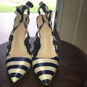 Navy and white sling back pumps.